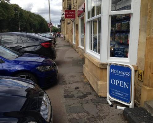 Carks parked outside shop